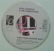 7inch Vinyl Single - Elvis Costello & The Attractions - Tokyo Storm Warning Pts 1 & 2 - White