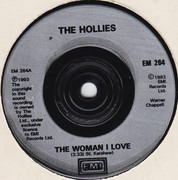 7inch Vinyl Single - The Hollies - The Woman I Love / Purple Rain (Live Version)